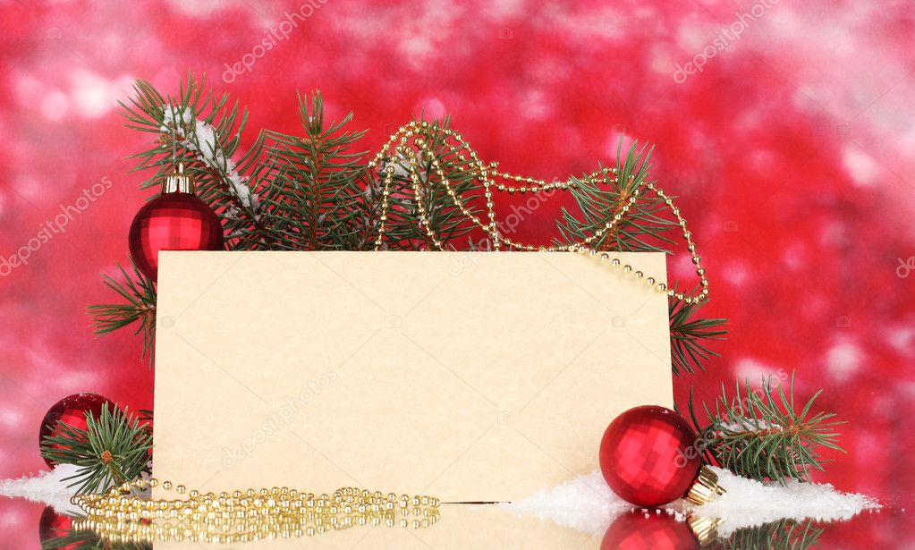 Blank postcard, Christmas balls and fir-tree on red background  Stock Photo #8115870