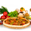 Delicious pizza on wooden board, vegetables, spices and oil isolated on whi — Stock Photo