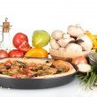 Delicious pizza on plate, vegetables and spices isolated on white — Stock Photo #8120126