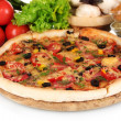 Delicious pizza on wooden board, vegetables, spices and oil isolated on whi — Stock Photo #8120137