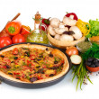 Delicious pizza on plate, vegetables and spices isolated on white — Stock Photo #8120163