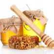 Royalty-Free Stock Photo: Two jars of honey, honeycombs and wooden drizzler isolated on white