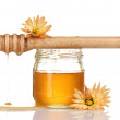 jar of honey and wooden drizzler isolated on white — Stock Photo