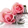 Perfume bottle and two pink rose isolated on white — Stock Photo