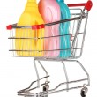 Shopping cart and detergent isolated on white — Stock Photo