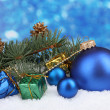 Christmas ball and green tree in the snow on blue — Stock Photo