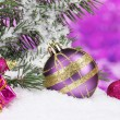 Christmas ball and toy with green tree in the snow on purple — Stock Photo #8121190