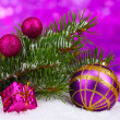 Christmas ball and toy with green tree in the snow on purple — ストック写真