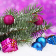 Royalty-Free Stock Photo: Christmas ball and toy with green tree in the snow on purple