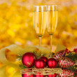 Two glasses with christmas decoration on yellow — Stock Photo #8121442