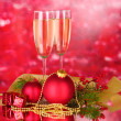 Two glasses with christmas decoration on red - Stok fotoğraf