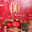 Two glasses with christmas decoration on red — Stock Photo