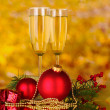 Two glasses with christmas decoration on yellow — Stock Photo #8121480