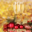 Two glasses with christmas decoration on yellow — Stock Photo