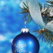 Christmas ball on the tree on blue — Stock Photo