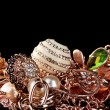 Various gold jewellery on black — Stock Photo #8121743