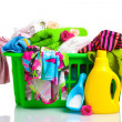 Clothes with detergent and washing powder in green plastic basket isolated — Stock Photo #8122059