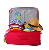 Open red suitcase with clothing isolated on a white — Stock Photo