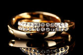 Golden ring on black — Stock Photo