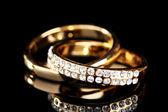 Golden ring on black — Stock Photo