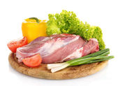 Raw meat and vegetables on a wooden board isolated on whitе — Стоковое фото