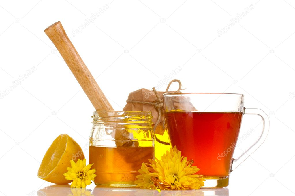 Honey, lemon and a cup of tea isolated on white — Stock Photo #8120409