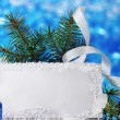 Blank postcard, Christmas balls and fir-tree on blue background - Stock Photo