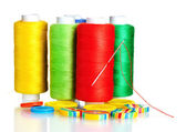 Many bobbin of thread with needle and buttons isolated on white — Stock Photo