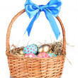 Colorful Easter eggs in the basket with a blue bow isolated on white — Stock Photo #8168137