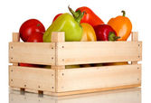Fresh paprica and tomatoes in wooden box isolated on white — Stock Photo