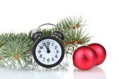 Green Christmas tree with toy and clock isolated on white — Stock Photo