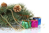 Green Christmas tree with gift and cones isolated on white — Stock Photo