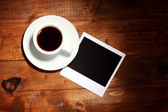 Photo paper with coffee on wooden background — Stock Photo