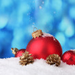 Beautiful blue Christmas balls and branch in snow on blue background — Stock Photo #8199258
