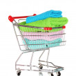 Shopping cart and towels isolated on white - Stock Photo