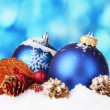 Beautiful blue Christmas balls and branch on snow on blue background — Stockfoto #8199269