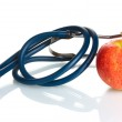 Medical stethoscope and red apple isolated on white — Stock Photo