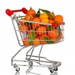 Ripe tasty tangerines in shopping cart isolated on white — Stock Photo