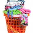 Clothes in orange plastic basket isolated on white — Stock Photo