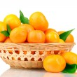 Royalty-Free Stock Photo: Tangerines with leaves in a beautiful basket isolated on white