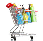 Shopping cart with detergent bottles isolated on white — Stock Photo