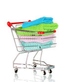 Shopping cart and towels isolated on white — Stock Photo
