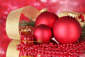 Christmas ball and green tree on red — Stock Photo