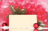 Blank postcard, Christmas balls and fir-tree on red background — Stock Photo