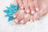 Hands with snow and snowflake closeup — Stock Photo