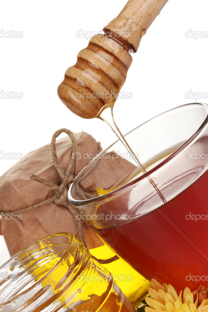 Honey and cup of tea isolated on white  Stock Photo #8199226