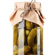 Marinated cucumbers in a glass jar isolated on white - Zdjęcie stockowe