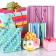 Bright gift bags and gifts isolated on white - Stockfoto