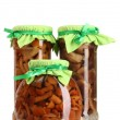 Delicious marinated mushrooms in the glass jars isolated on white - Zdjęcie stockowe