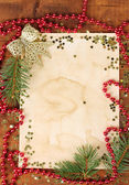 Christmas card on wooden table — Stock Photo